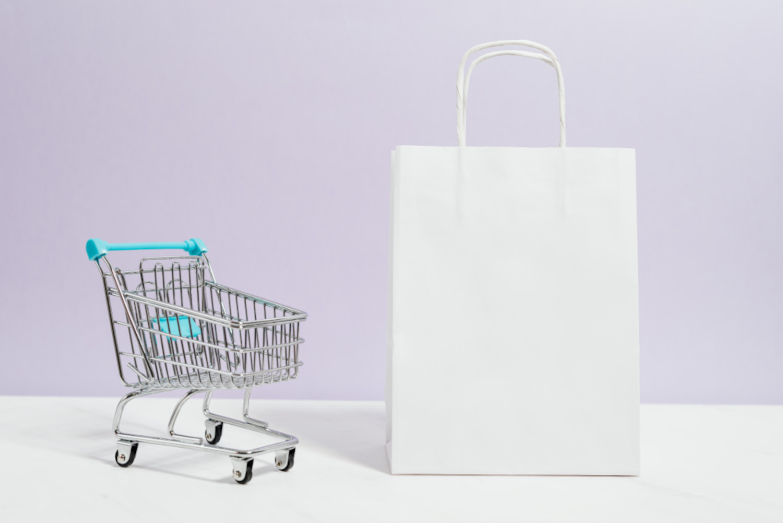 Der Konsumgütermarkt in Frankreich symbolisiert mit einem Einkaufswagen